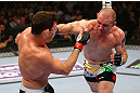 NEWARK, NJ - APRIL 27:  Alan Belcher (R) punches Michael Bisping (L) of England in thier middleweight bout during the UFC 159 event at the Prudential Center on April 27, 2013 in Newark, New Jersey.  (Photo by Al Bello/Zuffa LLC/Zuffa LLC Via Getty Images)