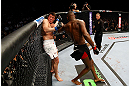 NEWARK, NJ - APRIL 27:  Chael Sonnen defends himself against Jon Jones in their light heavyweight championship bout during the UFC 159 event at the Prudential Center on April 27, 2013 in Newark, New Jersey.  (Photo by Al Bello/Zuffa LLC/Zuffa LLC Via Getty Images)