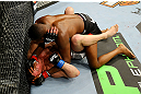 NEWARK, NJ - APRIL 27:  Jon Jones (top)  battles against Chael Sonnen (bottom) in the first round of their light heavyweight championship bout during the UFC 159 event at the Prudential Center on April 27, 2013 in Newark, New Jersey.  (Photo by Al Bello/Zuffa LLC/Zuffa LLC Via Getty Images)