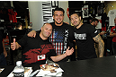 LAS VEGAS, NV - JULY 7:   (L-R) Matt Serra, Frank Mir and Dan Hardy sign autographs during the UFC Fan Expo at the Mandalay Bay Convention Center on July 7, 2012 in Las Vegas, Nevada.  (Photo by Al Powers/Zuffa LLC/Zuffa LLC via Getty Images)  *** Local Caption ***