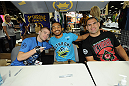 LAS VEGAS, NV - JULY 06:  (L-R) Michael McDonald, Benson Henderson and Cain Velasquez pose for fans at the UFC Fan Expo on July 6, 2012 in Las Vegas, Nevada. (Photo by Al Powers /Zuffa LLC/Zuffa LLC via Getty Images)
