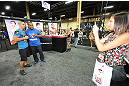 LAS VEGAS, NV - JULY 06:  Daniel Cormier interacts with fans at the UFC Fan Expo on July 6, 2012 in Las Vegas, Nevada. (Photo by Al Powers /Zuffa LLC/Zuffa LLC via Getty Images)