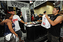 LAS VEGAS, NV - JULY 06:  Frank Mir poses with a fan at the UFC Fan Expo on July 6, 2012 in Las Vegas, Nevada. (Photo by Al Powers /Zuffa LLC/Zuffa LLC via Getty Images)