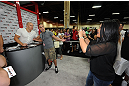 LAS VEGAS, NV - JULY 06: Goerges St-Pierre poses for pictures with a fan from the UFC Fan Expo on July 6, 2012 in Las Vegas, Nevada. (Photo by Al Powers /Zuffa LLC/Zuffa LLC via Getty Images)