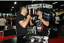LAS VEGAS, NV - JULY 7:  Carlos Condit faces off with a fan during the UFC Fan Expo at the Mandalay Bay Convention Center on July 7, 2012 in Las Vegas, Nevada.  (Photo by Al Powers/Zuffa LLC/Zuffa LLC via Getty Images)  *** Local Caption ***