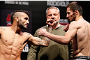 JARAGUA DO SUL, BRAZIL - MAY 17: (L-R) Opponents John Lineker and Azamat Gashimov face off during the UFC on FX weigh-in on May 17, 2013 at the Arena Jaragua in Jaragua do Sul, Santa Catarina, Brazil. (Photo by Josh Hedges/Zuffa LLC/Zuffa LLC via Getty Images)