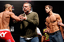 JARAGUA DO SUL, BRAZIL - MAY 17: (L-R) Opponents Vitor Belfort and Luke Rockhold are separated after a heated face-off during the UFC on FX weigh-in on May 17, 2013 at the Arena Jaragua in Jaragua do Sul, Santa Catarina, Brazil. (Photo by Josh Hedges/Zuffa LLC/Zuffa LLC via Getty Images)