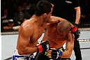 JARAGUA DO SUL, BRAZIL - MAY 18:   (L-R) Jussier Formiga punches Chris Cariaso in their flyweight bout during the UFC on FX event on May 18, 2013 at Arena Jaragua in Jaragua do Sul, Santa Catarina, Brazil.  (Photo by Josh Hedges/Zuffa LLC/Zuffa LLC via Getty Images)