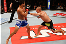 JARAGUA DO SUL, BRAZIL - MAY 18:   (R-L) Chris Cariaso punches Jussier Formiga in their flyweight bout during the UFC on FX event on May 18, 2013 at Arena Jaragua in Jaragua do Sul, Santa Catarina, Brazil.  (Photo by Josh Hedges/Zuffa LLC/Zuffa LLC via Getty Images)