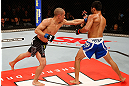 JARAGUA DO SUL, BRAZIL - MAY 18:   (L-R) Chris Cariaso punches Jussier Formiga in their flyweight bout during the UFC on FX event on May 18, 2013 at Arena Jaragua in Jaragua do Sul, Santa Catarina, Brazil.  (Photo by Josh Hedges/Zuffa LLC/Zuffa LLC via Getty Images)