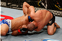 JARAGUA DO SUL, BRAZIL - MAY 18:   (R-L) Chris Cariaso attempts a guillotine choke submission against Jussier Formiga in their flyweight bout during the UFC on FX event on May 18, 2013 at Arena Jaragua in Jaragua do Sul, Santa Catarina, Brazil.  (Photo by Josh Hedges/Zuffa LLC/Zuffa LLC via Getty Images)