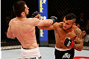 JARAGUA DO SUL, BRAZIL - MAY 18:   (R-L) John Lineker punches Azamat Gashimov in their flyweight bout during the UFC on FX event on May 18, 2013 at Arena Jaragua in Jaragua do Sul, Santa Catarina, Brazil.  (Photo by Josh Hedges/Zuffa LLC/Zuffa LLC via Getty Images)