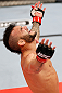 JARAGUA DO SUL, BRAZIL - MAY 18:   John Lineker reacts after knocking out Azamat Gashimov in their flyweight bout during the UFC on FX event on May 18, 2013 at Arena Jaragua in Jaragua do Sul, Santa Catarina, Brazil.  (Photo by Josh Hedges/Zuffa LLC/Zuffa LLC via Getty Images)