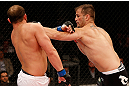 JARAGUA DO SUL, BRAZIL - MAY 18: (R-L) Fabio Maldonado punches Roger Hollett in their light heavyweight bout during the UFC on FX event on May 18, 2013 at Arena Jaragua in Jaragua do Sul, Santa Catarina, Brazil. (Photo by Josh Hedges/Zuffa LLC/Zuffa LLC via Getty Images)