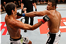 JARAGUA DO SUL, BRAZIL - MAY 18:   (R-L) Michel Prazeres punches Paulo Thiago in their welterweight bout during the UFC on FX event on May 18, 2013 at Arena Jaragua in Jaragua do Sul, Santa Catarina, Brazil.  (Photo by Josh Hedges/Zuffa LLC/Zuffa LLC via Getty Images)