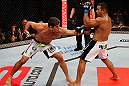 JARAGUA DO SUL, BRAZIL - MAY 18: (L-R) Paulo Thiago punches Michel Prazeres in their welterweight bout during the UFC on FX event on May 18, 2013 at Arena Jaragua in Jaragua do Sul, Santa Catarina, Brazil. (Photo by Josh Hedges/Zuffa LLC/Zuffa LLC via Getty Images)