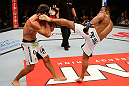 JARAGUA DO SUL, BRAZIL - MAY 18: (R-L) Michel Prazeres kicks Paulo Thiago in their welterweight bout during the UFC on FX event on May 18, 2013 at Arena Jaragua in Jaragua do Sul, Santa Catarina, Brazil. (Photo by Josh Hedges/Zuffa LLC/Zuffa LLC via Getty Images)