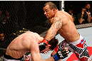 JARAGUA DO SUL, BRAZIL - MAY 18: (R-L) Gleison Tibau punches John Cholish in their lightweight bout during the UFC on FX event on May 18, 2013 at Arena Jaragua in Jaragua do Sul, Santa Catarina, Brazil. (Photo by Josh Hedges/Zuffa LLC/Zuffa LLC via Getty Images)