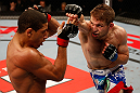 JARAGUA DO SUL, BRAZIL - MAY 18: (R-L) Nik Lentz punches Hacran Dias in their featherweight bout during the UFC on FX event on May 18, 2013 at Arena Jaragua in Jaragua do Sul, Santa Catarina, Brazil. (Photo by Josh Hedges/Zuffa LLC/Zuffa LLC via Getty Images)