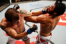 JARAGUA DO SUL, BRAZIL - MAY 18: (L-R) Joao Zeferino punches Rafael Natal in their middleweight bout during the UFC on FX event on May 18, 2013 at Arena Jaragua in Jaragua do Sul, Santa Catarina, Brazil. (Photo by Josh Hedges/Zuffa LLC/Zuffa LLC via Getty Images)