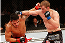 JARAGUA DO SUL, BRAZIL - MAY 18: (R-L) Evan Dunham punches Rafael dos Anjos in their lightweight bout during the UFC on FX event on May 18, 2013 at Arena Jaragua in Jaragua do Sul, Santa Catarina, Brazil. (Photo by Josh Hedges/Zuffa LLC/Zuffa LLC via Getty Images)
