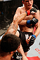 JARAGUA DO SUL, BRAZIL - MAY 18: (L-R) Rafael dos Anjos punches Evan Dunham in their lightweight bout during the UFC on FX event on May 18, 2013 at Arena Jaragua in Jaragua do Sul, Santa Catarina, Brazil. (Photo by Josh Hedges/Zuffa LLC/Zuffa LLC via Getty Images)