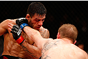 JARAGUA DO SUL, BRAZIL - MAY 18: (R-L) Rafael dos Anjos punches Evan Dunham in their lightweight bout during the UFC on FX event on May 18, 2013 at Arena Jaragua in Jaragua do Sul, Santa Catarina, Brazil. (Photo by Josh Hedges/Zuffa LLC/Zuffa LLC via Getty Images)