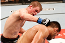 JARAGUA DO SUL, BRAZIL - MAY 18:   (L-R) Evan Dunham punches Rafael dos Anjos in their lightweight bout during the UFC on FX event on May 18, 2013 at Arena Jaragua in Jaragua do Sul, Santa Catarina, Brazil.  (Photo by Josh Hedges/Zuffa LLC/Zuffa LLC via Getty Images)