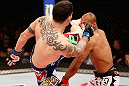 "JARAGUA DO SUL, BRAZIL - MAY 18:   (L-R) Chris Camozzi kicks Ronaldo ""Jacare"" Souza in their middleweight bout during the UFC on FX event on May 18, 2013 at Arena Jaragua in Jaragua do Sul, Santa Catarina, Brazil.  (Photo by Josh Hedges/Zuffa LLC/Zuffa LLC via Getty Images)"