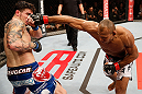 "JARAGUA DO SUL, BRAZIL - MAY 18:   (R-L) Ronaldo ""Jacare"" Souza punches Chris Camozzi in their middleweight bout during the UFC on FX event on May 18, 2013 at Arena Jaragua in Jaragua do Sul, Santa Catarina, Brazil.  (Photo by Josh Hedges/Zuffa LLC/Zuffa LLC via Getty Images)"