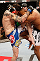 JARAGUA DO SUL, BRAZIL - MAY 18:   (L-R) Chris Camozzi knees Ronaldo &#39;Jacare&#39; Souza in their middleweight bout during the UFC on FX event on May 18, 2013 at Arena Jaragua in Jaragua do Sul, Santa Catarina, Brazil.  (Photo by Josh Hedges/Zuffa LLC/Zuffa LLC via Getty Images)