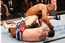 JARAGUA DO SUL, BRAZIL - MAY 18:   (L-R) Ronaldo 'Jacare' Souza punches Chris Camozzi in their middleweight bout during the UFC on FX event on May 18, 2013 at Arena Jaragua in Jaragua do Sul, Santa Catarina, Brazil.  (Photo by Josh Hedges/Zuffa LLC/Zuffa LLC via Getty Images)
