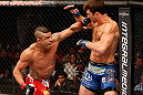 JARAGUA DO SUL, BRAZIL - MAY 18:   (L-R) Vitor Belfort punches Luke Rockhold in their middleweight bout during the UFC on FX event on May 18, 2013 at Arena Jaragua in Jaragua do Sul, Santa Catarina, Brazil.  (Photo by Josh Hedges/Zuffa LLC/Zuffa LLC via Getty Images)