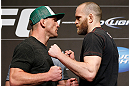 LAS VEGAS, NV - MAY 23:   (L-R) Opponents Gray Maynard and T.J. Grant face off during the UFC 160 Ultimate Media Day at the MGM Grand Hotel/Casino on May 23, 2013 in Las Vegas, Nevada.  (Photo by Josh Hedges/Zuffa LLC/Zuffa LLC via Getty Images)