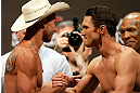 "LAS VEGAS, NV - MAY 24:   (L-R) Opponents Donald ""Cowboy"" Cerrone and Karl ""K.J."" Noons shake hands during the UFC 160 weigh-in at the MGM Grand Garden Arena on May 24, 2013 in Las Vegas, Nevada.  (Photo by Josh Hedges/Zuffa LLC/Zuffa LLC via Getty Images)"