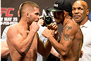 LAS VEGAS, NV - MAY 24:   (L-R) Opponents Jeremy Stephens and Estevan Payan face off during the UFC 160 weigh-in at the MGM Grand Garden Arena on May 24, 2013 in Las Vegas, Nevada.  (Photo by Josh Hedges/Zuffa LLC/Zuffa LLC via Getty Images)