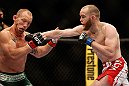 LAS VEGAS, NV - MAY 25:   (R-L) T.J. Grant punches Gray Maynard in their lightweight bout during UFC 160 at the MGM Grand Garden Arena on May 25, 2013 in Las Vegas, Nevada.  (Photo by Josh Hedges/Zuffa LLC/Zuffa LLC via Getty Images)  *** Local Caption *** Gray Maynard; T.J. Grant