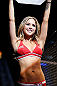 LAS VEGAS, NV - MAY 25:   UFC Octagon Girl Brittney Palmer introuces round one of Bowles vs Roop in their bantamweight bout during UFC 160 at the MGM Grand Garden Arena on May 25, 2013 in Las Vegas, Nevada.  (Photo by Josh Hedges/Zuffa LLC/Zuffa LLC via Getty Images)  *** Local Caption *** Brittney Palmer