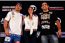 "FORTALEZA, BRAZIL - JUNE 06:  Opponents Antonio Rodrigo ""Minotauro"" Nogueira (L) and Fabricio Werdum pose for photos with UFC vice president Grace Tourinho at Centro de Eventos do Ceara on June 6, 2013 in Fortaleza, Ceara, Brazil.  (Photo by Josh Hedges/Zuffa LLC/Zuffa LLC via Getty Images)"