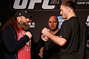 WINNIPEG, CANADA - JUNE 13:  (L-R) Opponents Roy Nelson and Stipe Miocic face off during the UFC 161 media day at The Met on June 13, 2013 in Winnipeg, Manitoba, Canada.  (Photo by Josh Hedges/Zuffa LLC/Zuffa LLC via Getty Images)