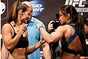 WINNIPEG, CANADA - JUNE 14:  (L-R) Opponents Alexis Davis and Rosi Sexton face off during the UFC 161 weigh-in at the MTS Centre on June 14, 2013 in Winnipeg, Manitoba, Canada.  (Photo by Josh Hedges/Zuffa LLC/Zuffa LLC via Getty Images)