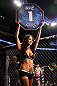WINNIPEG, CANADA - JUNE 15:  UFC Octagon Girl Arianny Celeste introduces a round during the UFC 161 event at the MTS Centre on June 15, 2013 in Winnipeg, Manitoba, Canada.  (Photo by Josh Hedges/Zuffa LLC/Zuffa LLC via Getty Images)