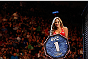 WINNIPEG, CANADA - JUNE 15:  UFC Octagon Girl Brittney Palmer introduces a round during the UFC 161 event at the MTS Centre on June 15, 2013 in Winnipeg, Manitoba, Canada.  (Photo by Josh Hedges/Zuffa LLC/Zuffa LLC via Getty Images)