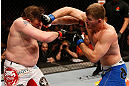 WINNIPEG, CANADA - JUNE 15:  (R-L) Stipe Miocic punches