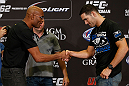 LAS VEGAS, NV - JULY 04:  (L-R) Opponents Anderson Silva and Chris Weidman shake hands during the final UFC 162 press conference at the MGM Grand Hotel/Casino on July 4, 2013 in Las Vegas, Nevada.  (Photo by Josh Hedges/Zuffa LLC/Zuffa LLC via Getty Images)