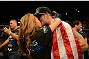 LAS VEGAS, NV - JULY 06:  Chris Weidman (right) celebrates with his wife after his victory over Anderson Silva in their UFC middleweight championship fight during the UFC 162 event inside the MGM Grand Garden Arena on July 6, 2013 in Las Vegas, Nevada.  (Photo by Donald Miralle/Zuffa LLC/Zuffa LLC via Getty Images) *** Local Caption *** Anderson Silva; Chris Weidman