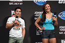 SEATTLE, WA - JULY 26:  Joseph Benavidez (L) and UFC women's bantamweight Miesha Tate interacts with fans during a Q&A session before the official UFC on FOX weigh-in at Key Arena on July 26, 2013 in Seattle, Washington.  (Photo by Jeff Bottari/Zuffa LLC/Zuffa LLC via Getty Images)