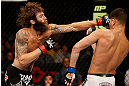 SEATTLE, WA - JULY 27: (L-R) Michael Chiesa punches Jorge Masvidal in their lightweight bout during the UFC on FOX event at Key Arena on July 27, 2013 in Seattle, Washington. (Photo by Josh Hedges/Zuffa LLC/Zuffa LLC via Getty Images) *** Local Caption *** Michael Chiesa; Jorge Masvidal