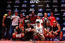 RIO DE JANEIRO, BRAZIL - AUGUST 01:  Members from the band Tihuana pose for a photo with UFC fighters before an open training session for fans and media at Circo Voador on August 1, 2013 in Rio de Janeiro, Brazil. (Photo by Josh Hedges/Zuffa LLC/Zuffa LLC via Getty Images)