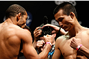 "RIO DE JANEIRO, BRAZIL - AUGUST 02:  (L-R) Opponents Jose Aldo and ""The Korean Zombie"" Chan Sung Jung face off during the UFC 163 weigh-in at HSBC Arena on August 2, 2013 in Rio de Janeiro, Brazil. (Photo by Josh Hedges/Zuffa LLC/Zuffa LLC via Getty Images)"